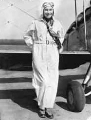 Jean Batten wearing her renowned white flying suit c.1936 Permission of the Alexander Turnbull Library, National Library of New Zealand, Te Puna Matauranga o Aotearoa, must be obtained before any re-use of this image.