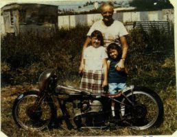 "Burt, 1969, in front of his shed with his ""wee friends Denise L & Heather Butler"" and his 1936 Velocette – Permission Munro Family Collection"