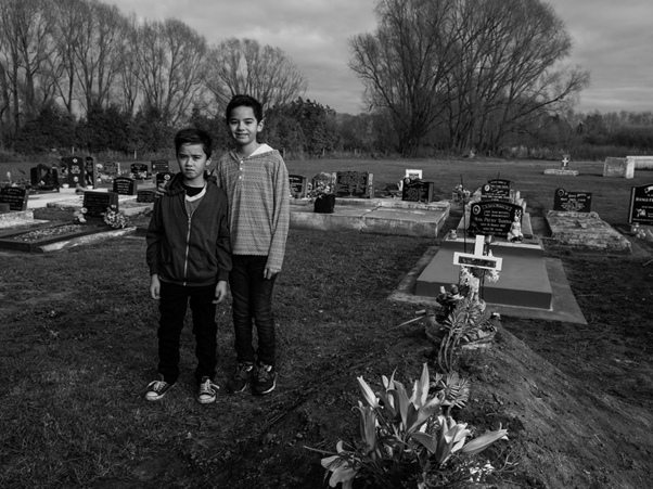 Our mokos Te Roera and Tumanako Jujnovich, Kaylene's youngest sons, at her graveside, Waiohiki.