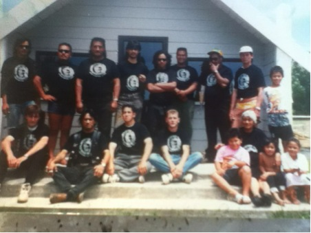 The Waiohiki Conservation Corps and Nanny Millie Hadfield and mokopuna outside the Waiohiki whare iti 1995