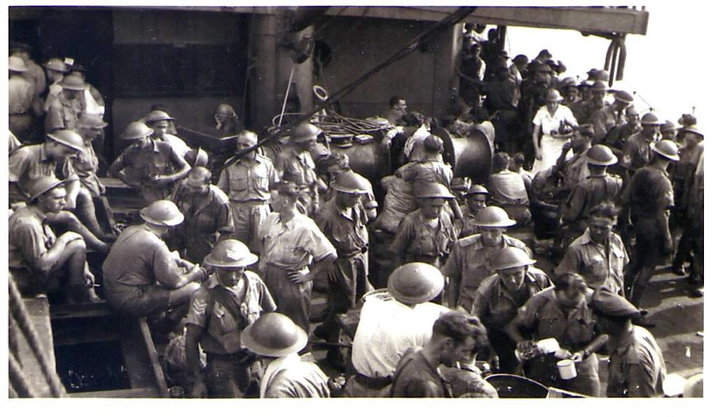 Australian and New Zealand Military personnel being evacuated from Singapore on the Empire Star