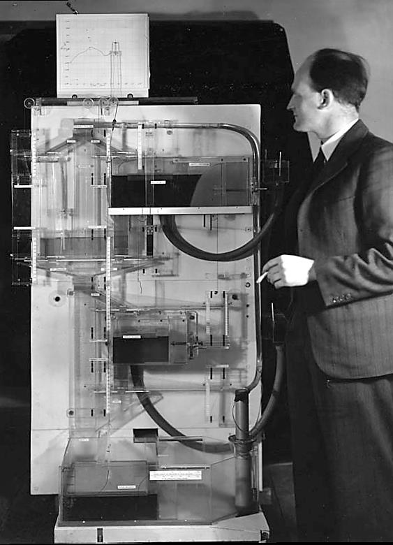 "A.W.H ""Bill"" Phillips demonstrating his Monetary National Income Analogue Computer"