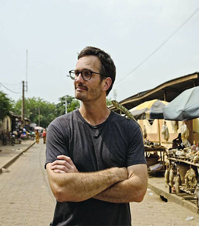 Who is Dark Tourist Host David Farrier?