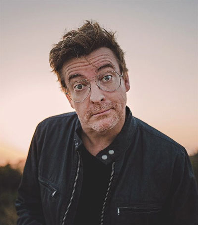 Rhys Darby Stands up on Stage in Washington